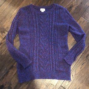 Woman's purple sweater